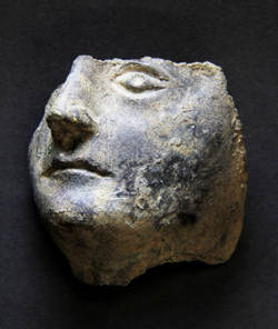 Fragment-of-a-face-from-a-figurine